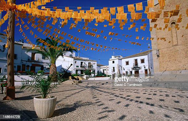 The old town square decorated with bunting in the regional colours.