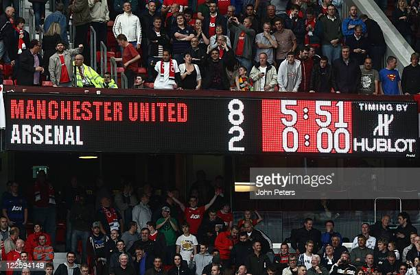 The Old Trafford scoreboard shows the final score after the Barclays Premier League match betwen Manchester United and Arsenal at Old Trafford on...