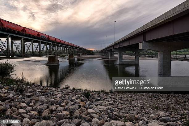 the old train bridge and new traffic bridge - south saskatchewan river stock photos and pictures