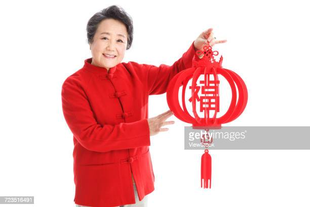 The old woman celebrates the Spring Festival