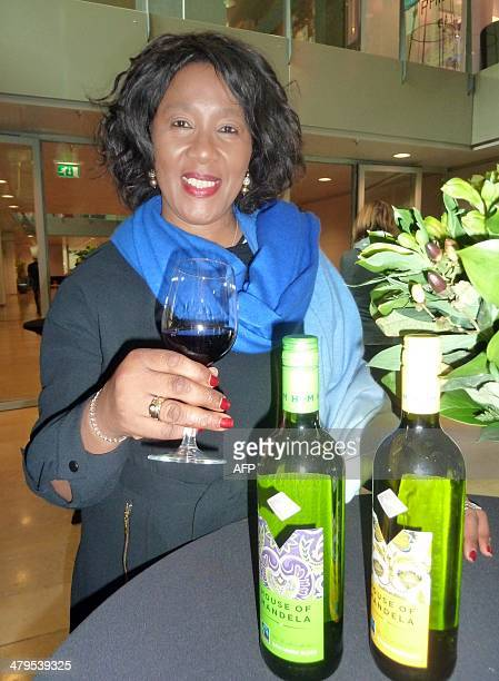 The oldest daughter of late Nelson Mandela Makaziwe Mandela poses on March 19 2014 in Amsterdam with the Mandela wine collection Makaziwe Mandela and...