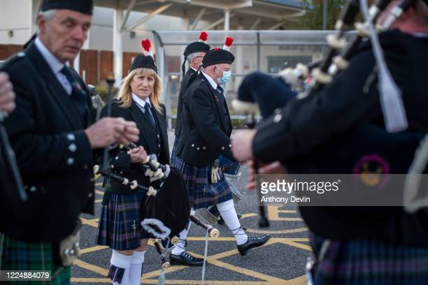 The Oldham Scottish and Manchester Community pipe bands arrive to participate in the Clap for Carers at Tameside General Hospital in AshtonUnderLyne...