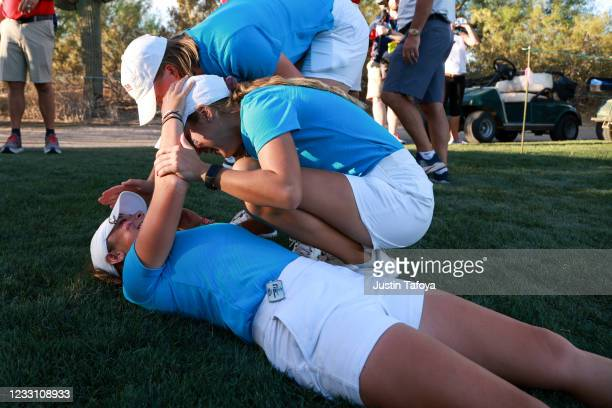 The Ole Miss Rebels celebrate advancing to the finals in match play during the Division I Women's Golf Championship held at the Grayhawk Golf Club on...