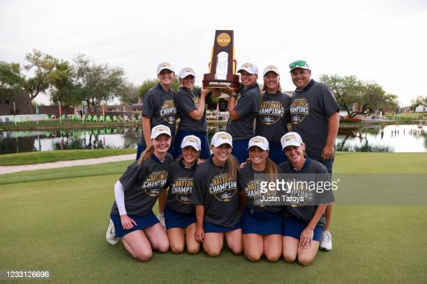 The Ole Miss Rebels pose with the trophy after winning the Division I Womens Golf Championship held at the Grayhawk Golf Club on May 26, 2021 in...