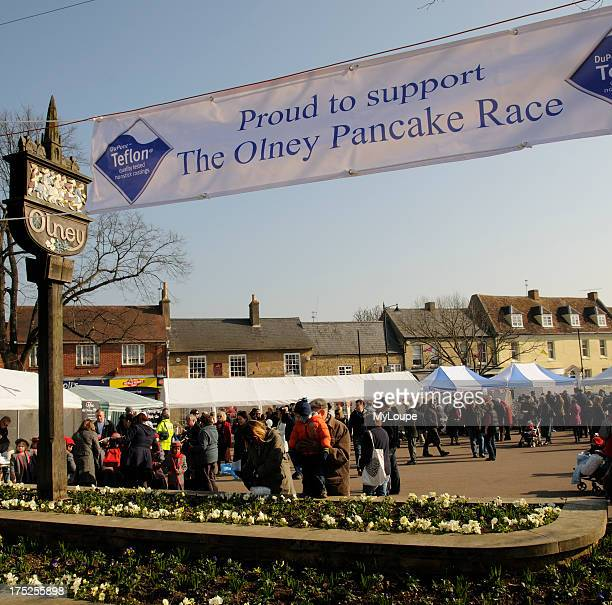 The Olney town sign and banner promoting the annual Pancake Race which has been run in this historic Buckinghamshire town since 1445