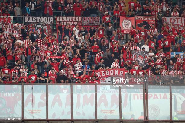 The Olympiacos FC fans show their support before the UEFA Europa League Group F match between AC Milan and Olympiacos at Stadio Giuseppe Meazza on...