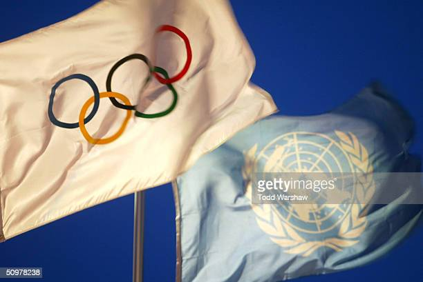 The Olympic and United Nations flags fly over the grounds of the United Nations during Day 15 of the ATHENS 2004 Olympic Torch Relay on June 19 2004...