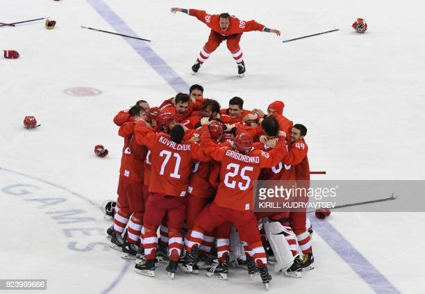 TOPSHOT The Olympic Athletes from Russia celebrate winning the men's gold medal ice hockey match between the Olympic Athletes from Russia and Germany...