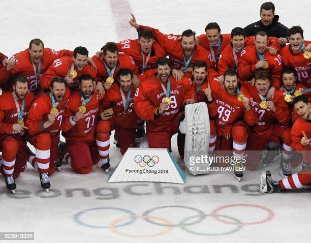 The Olympic Athletes from Russia team pose with their gold medals after the medal ceremony in the men's gold medal ice hockey match between the...