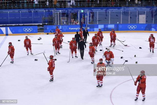 The Olympic Athletes from Russia's team reacts after losing the women's bronze medal ice hockey match between Finland and the Olympic Athletes from...