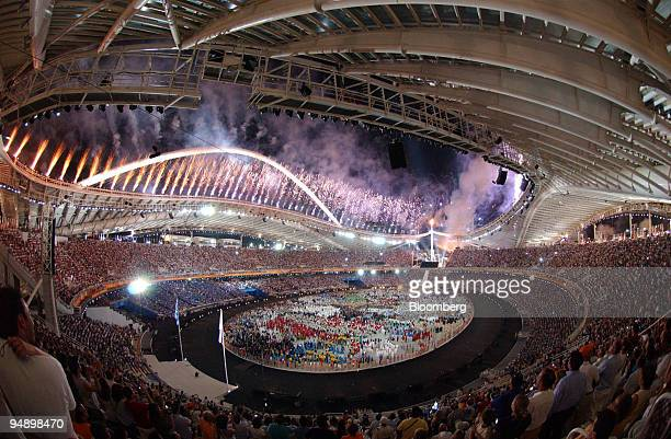 The Olympic athletes of many nations assemble during the opening ceremony of the Athens Olympics at the Athens Olympic StadiumMarousiGreece Friday...