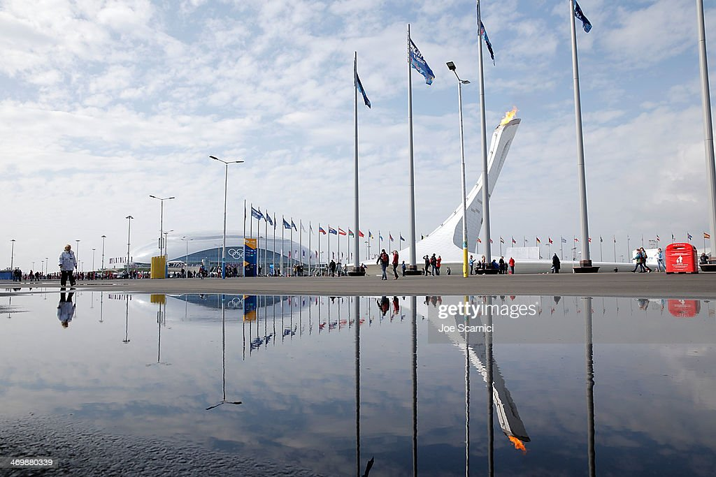 The Olympic Cauldron and Bolshoy Ice Dome are reflected in a puddle in the Olympic Park during the Sochi 2014 Winter Olympics on February 17, 2014 in Sochi, Russia.