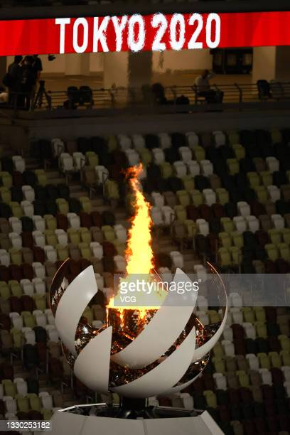 The Olympic cauldron and flame are seen after the Opening Ceremony of the Tokyo 2020 Olympic Games at Olympic Stadium on July 24, 2021 in Tokyo,...