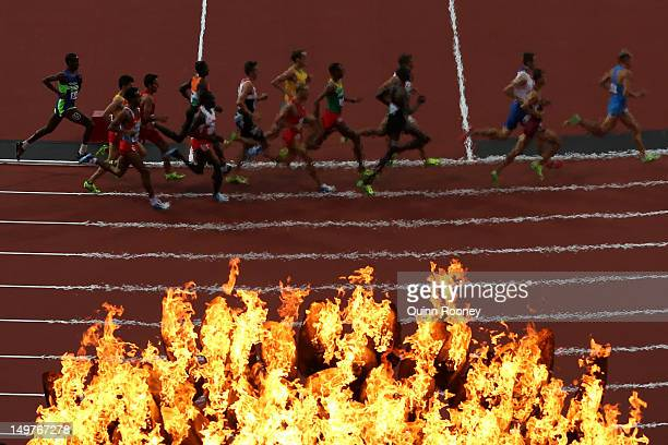 The Olympic Cauldron burns as athletes compete in the Men's 1500m Round 1 Heats on Day 7 of the London 2012 Olympic Games at Olympic Stadium on...