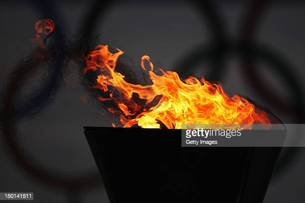 The Olympic cauldron burns at sunset on Day 14 of the London 2012 Olympic Games at the Weymouth Portland Venue at Weymouth Harbour on August 10 2012...