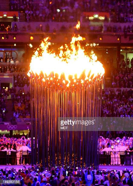 The Olympic cauldron burns in Olympic Stadium during the Opening Ceremony for the London 2012 Summer Olympic Games in London England Friday July 27...
