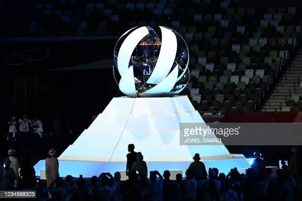 The Olympic cauldron closes after the Olympic flame was extinguished during the closing ceremony of the Tokyo 2020 Olympic Games, on August 8, 2021...