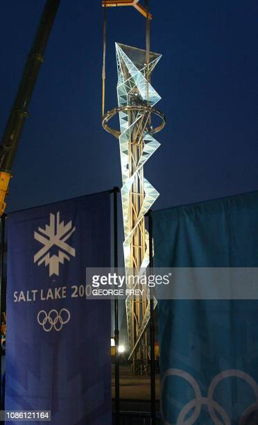 The Olympic cauldron is held by a crane at its unveiling early 08 January 2002 at the Olympic Stadium in Salt Lake City Utah The cauldron is made of...
