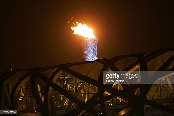 The Olympic cauldron is kindled during the Opening Ceremony for the Beijing 2008 Olympic Games on August 8 2008 in Beijing China