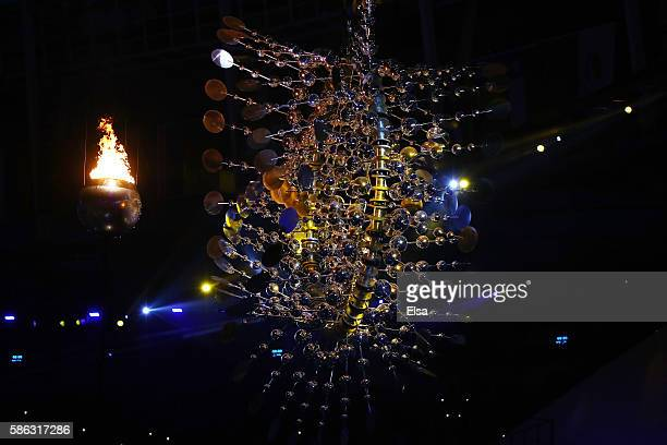 The Olympic Cauldron is lit alongside a sculpture by Anthony Howe during the Opening Ceremony of the Rio 2016 Olympic Games at Maracana Stadium on...