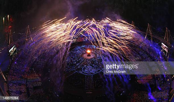 The Olympic Cauldron is lit as fireworks go of during the Opening Ceremony of the London 2012 Olympic Games at the Olympic Stadium on July 27 2012 in...