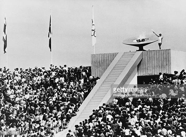 The Olympic cauldron is lit by Mexican hurdler Enriqueta Basilio during the opening ceremony of the 1968 Summer Olympics in Mexico City, Mexico, 12st...