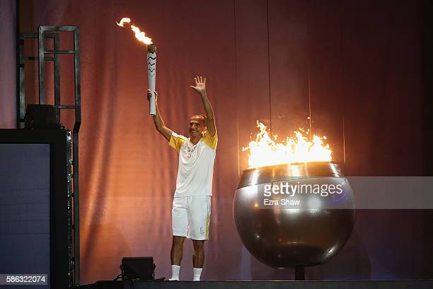 The Olympic Cauldron is lit by the final torch bearer and former marathon runner Vanderlei Cordeiro de Lima during the Opening Ceremony of the Rio...