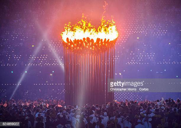 The Olympic Cauldron is lit during Opening Ceremonies at the 2012 London Olympic Games. The cauldron by designer Thomas Heatherwick was made up of...