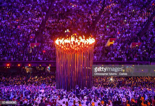 The Olympic Cauldron is lit during Opening Ceremonies at the 2012 London Olympic Games The cauldron by designer Thomas Heatherwick was made up of 204...
