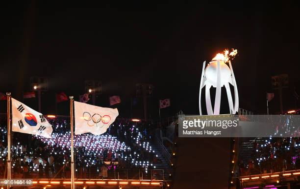 The Olympic Cauldron is lit during the Opening Ceremony of the PyeongChang 2018 Winter Olympic Games at PyeongChang Olympic Stadium on February 9,...