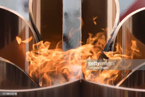 The Olympic cauldron is lit using the Olympic flame during the Tokyo 2020 Olympic Games Flame Arrival Ceremony at the Japan Air SelfDefense Force...