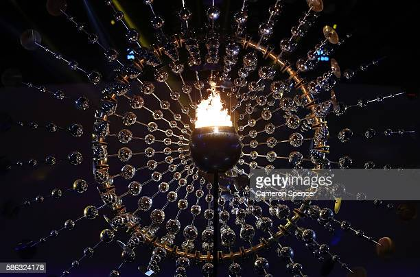 The Olympic Cauldron is seen lit during the Opening Ceremony of the Rio 2016 Olympic Games at Maracana Stadium on August 5 2016 in Rio de Janeiro...
