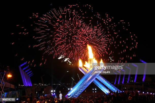 The Olympic Cauldron is seen shortly after being lit as fireworks are shot off during the Opening Ceremony of the 2010 Vancouver Winter Olympics at...