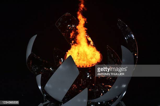 The Olympic Cauldron lights up during the closing ceremony of the Tokyo 2020 Olympic Games, at the Olympic Stadium, in Tokyo, on August 8, 2021.