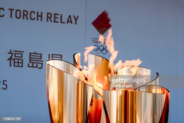 The Olympic cauldron seen lit at the 'Flame of Recovery' special exhibition at Aquamarine Park after it was announced that the Tokyo Olympic and...