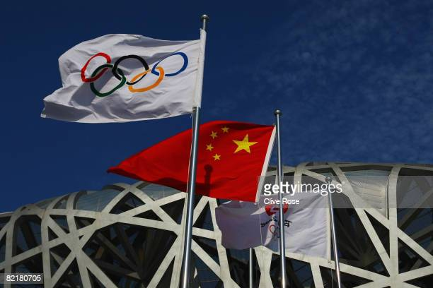 The Olympic flag and Chinese national flag fly outside the National Stadium during previews ahead of the Beijing 2008 Olympic Games on August 5 2008...