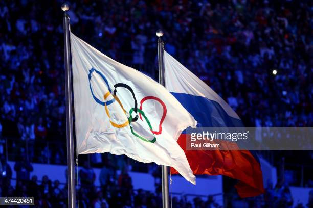The Olympic flag and Russian flag are raised as the Russian National Anthem is sung during the 2014 Sochi Winter Olympics Closing Ceremony at Fisht...