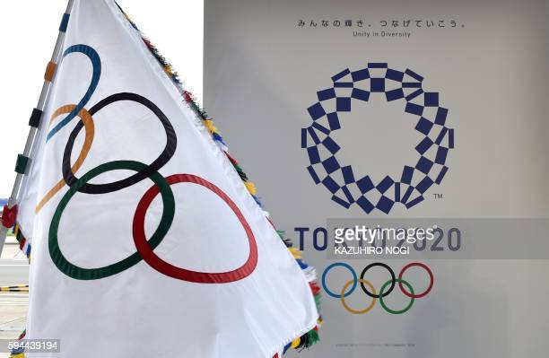 The Olympic flag and the logo of the Tokyo 2020 are displayed during the official flag arrival ceremony at the Tokyo's Haneda airport on August 24...