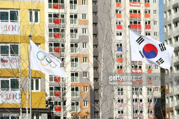 The Olympic flag and the Republic of Korea flag are seen during Team Welcome Ceremony ahead of the PyeongChang 2018 Winter Olympic Games at Gangneung...