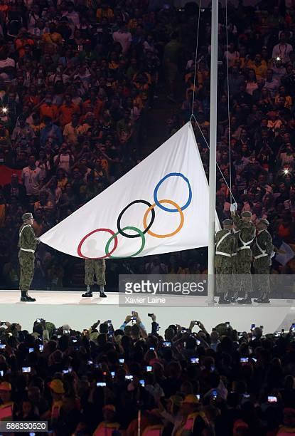 the olympic flag during the Olympic Games opening ceremony at Maracana Stadium on August 5 2016 in Rio de Janeiro Brazil