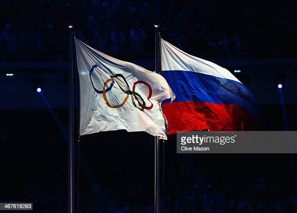 The Olympic flag flies next to the Russian flag during the Opening Ceremony of the Sochi 2014 Winter Olympics at Fisht Olympic Stadium on February 7...