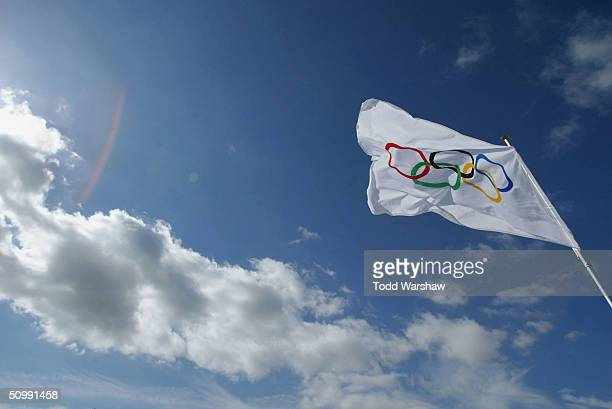 The Olympic Flag flies over Geneva during Day 20 of the ATHENS 2004 Olympic Torch Relay on June 24 2004 in Geneva Switzerland The Olympic Flame...