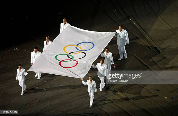 The Olympic flag is carried away during the closing ceremony of the Athens 2004 Summer Olympic Games on August 29, 2004 at the Sports Complex Olympic...