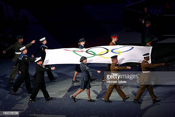 The Olympic flag is carried by military personel during the Closing Ceremony on Day 16 of the London 2012 Olympic Games at Olympic Stadium on August...