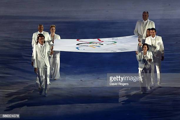 The Olympic flag is carried during the Opening Ceremony of the Rio 2016 Olympic Games at Maracana Stadium on August 5 2016 in Rio de Janeiro Brazil