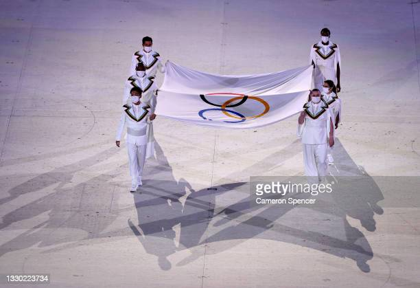 The Olympic flag is carried into the stadium during the Opening Ceremony of the Tokyo 2020 Olympic Games at Olympic Stadium on July 23, 2021 in...