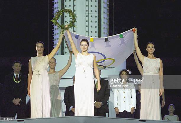 The Olympic flag is handed over to Greece October 1, 2000 at the closing ceremony of the Sydney 2000 Olympic Games in Sydney, Australia. Athens will...