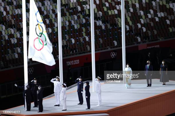 The olympic flag is lowered during the Closing Ceremony of the Tokyo 2020 Olympic Games at Olympic Stadium on August 08, 2021 in Tokyo, Japan.