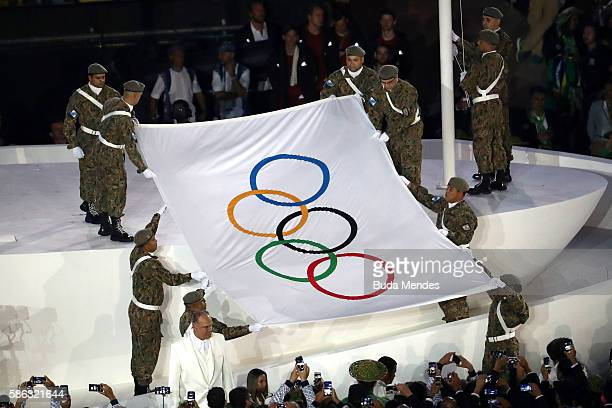 The Olympic flag is presented during the Opening Ceremony of the Rio 2016 Olympic Games at Maracana Stadium on August 5, 2016 in Rio de Janeiro,...