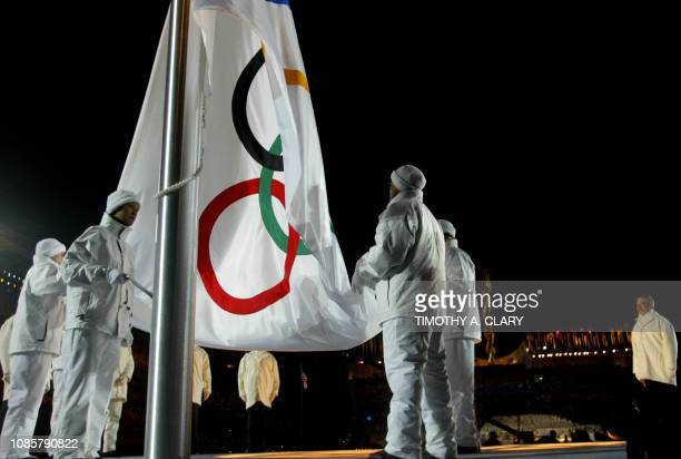 The Olympic flag is raised 08 February 2002 during the opening ceremonies of the XIX Winter Olympics at the Rice Eccles Stadium in Salt Lake City...